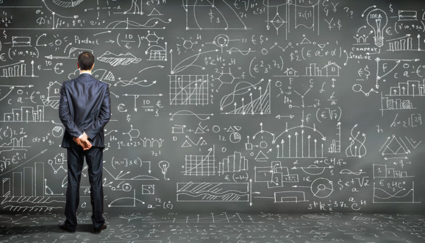 Big data: man standing in front of a blackboard full of equations