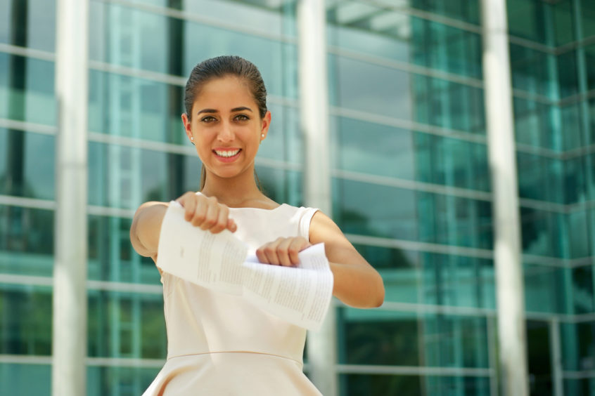 Employee churn: woman tearing a paper contract